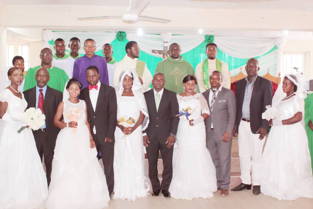 The Parish Priest and the Associate Priest with the 5 couples that were wedded on 23rd February 2019